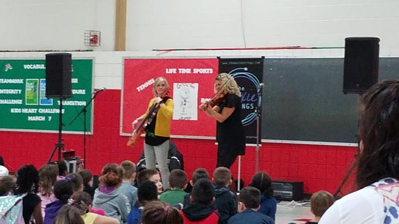 Visiting artists, Moxie Strings, perform for Jackson Elementary students