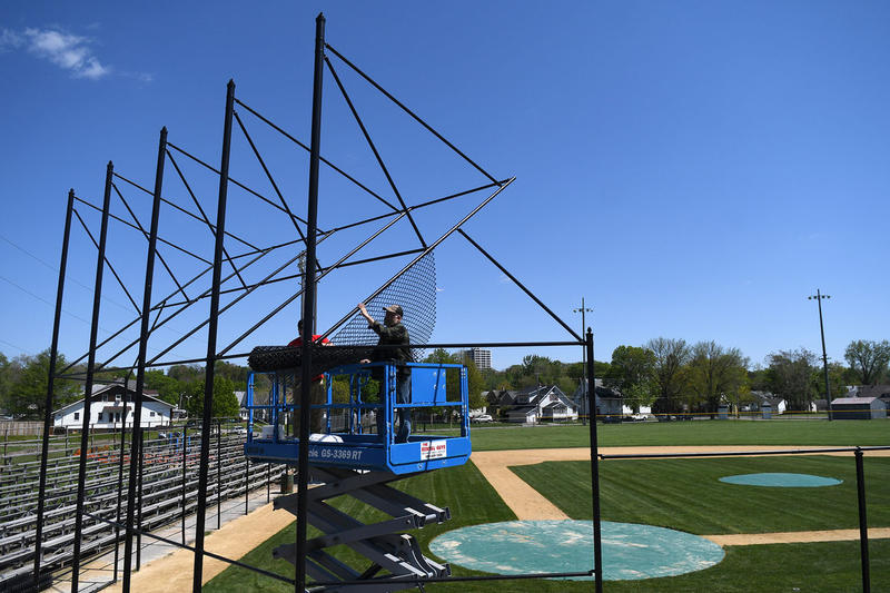 putting up a new backstop in Douglas Park in R.I.