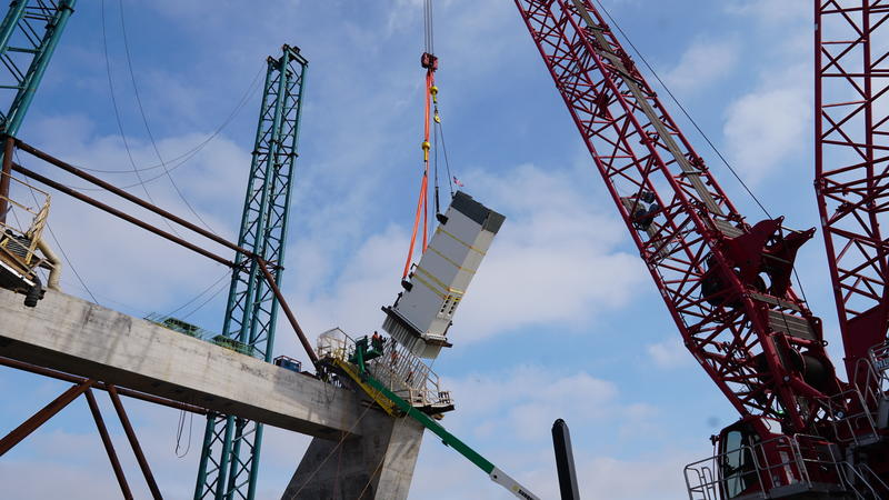 Placement of the first steel arch section onto one of four central piers, Saturday, March 2nd, 2019