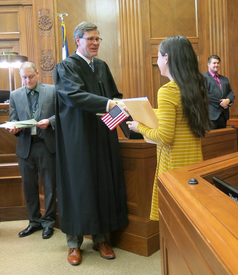 Federal Magistrate Judge Stephen Jackson presided at the ceremony