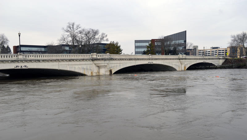 Water nearly reaches the arches under Jefferson Boulevard