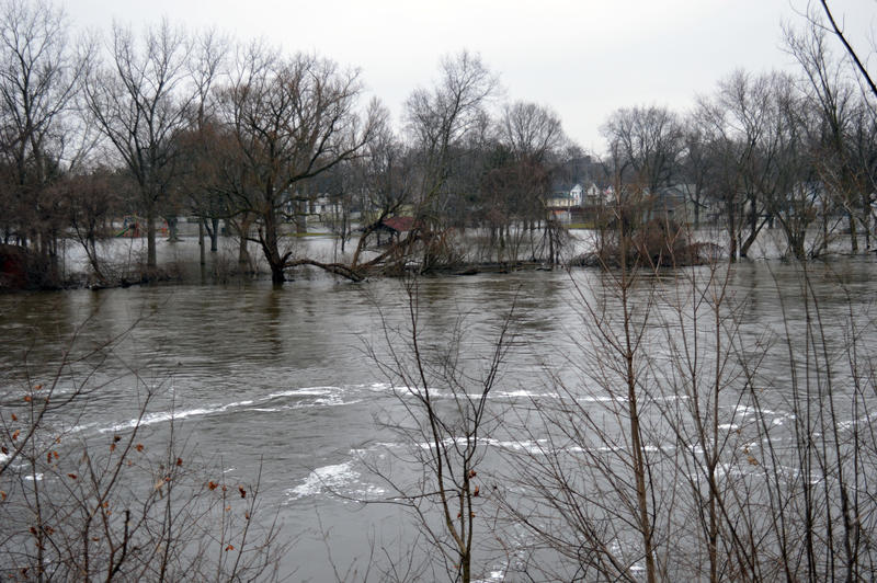 The river swells to cover houses and a pavillion in water