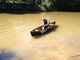 Baton beings trip down Ohio River by canoe.