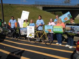 Members of Ohio Valley Environmental Coalition and Wheeling Water Warriors hold a rally in Huntington.