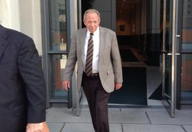 Mingo County Commissioner David Baisden exits the U.S. District Courthouse in Charleston after pleading guilty to federal extortion charges on October 1.