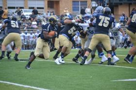 Shepherd University's Allen Cross looks for running room against Urbana during a recent football game.