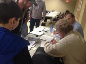 Miners attend a rapid response meeting to find apply for federal funds in 2013.