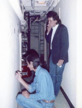 Townes Van Zandt signs the wall backstage at the Capitol Plaza Theater while Guy Clark looks on. The two performed on Mountain Stage together in 1987 and again in 1991.