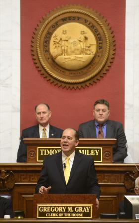 Governor Earl Ray Tomblin issues his State of the State Address in the House Chamber. Seated behind him are Senate President Jeff Kessler and newly elected House Speaker Tim Miley.