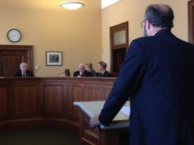 Legislative Counsel Doren Burrell explains House Bill 4175 to the Senate Committee on Economic Development.