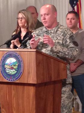 Col. Greg Grant explains the water testing process during a press conference at the Capitol Saturday night.