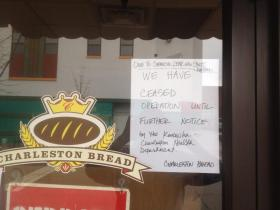 Signs like this one at Charleston Bread on Capitol Street illustrate how local businesses were forced to temporarily close in the wake of the Jan. 9 spill. They and other businesses soon reopened but they took a significant hit because of the water crisis.