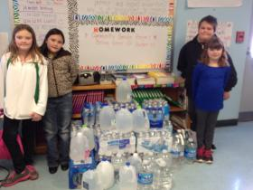 Ms. Haymond's third grade class collected water to send to a town in Southern W.Va.