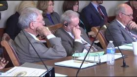 Members of the House Judiciary Committee look over H.B. 4414, relating to the solicitation of public employees by an elected officer of the state.