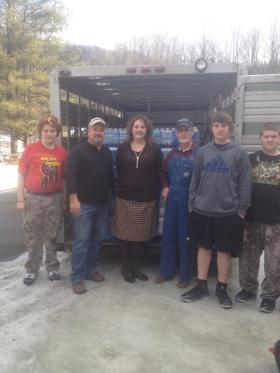 The Saddle Club out of N.C. donated 250 cases on Wed. Feb. 19, 2014. Virginia Lusk (middle) says she will continue to collect and distribute water at Herndon Consolidated School.