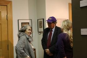 Jean Barnes Peters talks to WVU Professors Dr. Joel Beeson and Dana Coester in 2010 at the opening of the Soldiers of the Coalfields exhibit at the Kimball War Memorial.