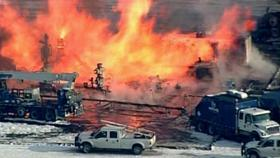 Crews battle a fire at a gas well in Greene County, Pa., on Tuesday, Feb. 11, 2014.