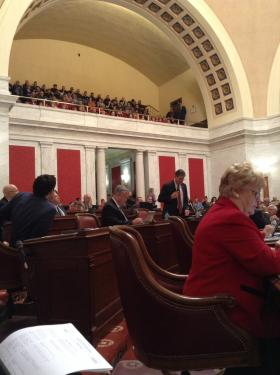 Members of the state Senate gathered in the chamber for a floor session Monday.