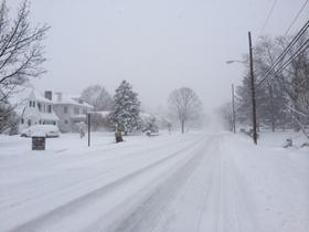 Despite the fact that Martinsburg city workers plowed the roads much of the night they were still snow covered Thursday morning.