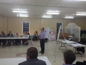 Kent Spellman (center) talks during a recent meeting of Turn This Town Around in Grafton.