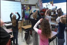 Mrs. Brenda Lee leads her class as they spell out words while participating in physical activity. Brenda is West Virginia Education Association President Dale Lee's wife.