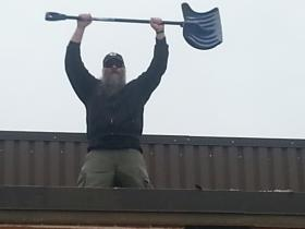 Larry Dowling conquers the snow on our roof in Morgantown