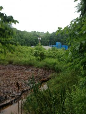 Above ground waste pits sit close to the underground injection wells in Fayette County.