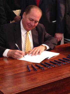 Gov. Tomblin signed a ceremonial bill after the completion of the 2014 legislative session.