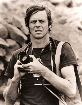 George Plimpton photographing birds in Africa.