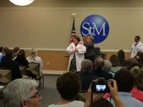 Physical therapy student Erin Jordan receives white coat.