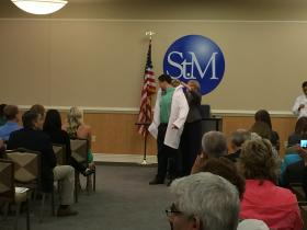 Physical therapy student Gabriel Blanco receives white coat.