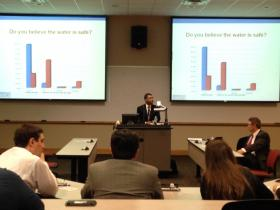 Dr. Rahul Gupta shares survey results with a crowd at the University of Charleston School of Pharmacy.