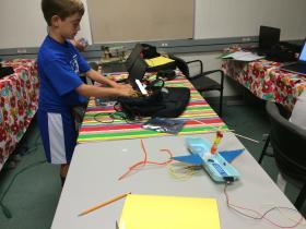 Landon Mosser constructs a planecopter robot.