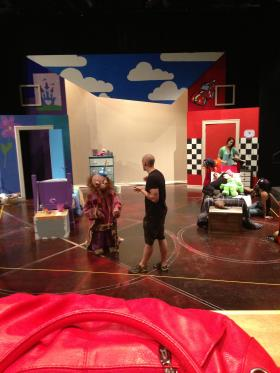 Director Jim Knipple (center) speaks with Adam Messenger (the puppet) as Hannah Redmond (The Unlucky Princess) looks on.