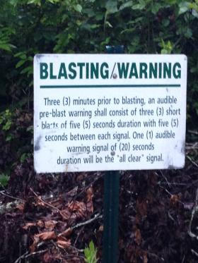 Blast warning signs are posted throughout the forest on sites near Middle Lick Mountain.