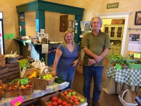 Christa Blais, owner of All Things Herbal Local Market, and Viktor Skaggs, a local organic farmer - seen with a variety of fresh produce at the store.