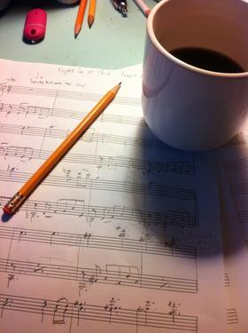 "Good (My idea of good is a bit introverted.) lighting, a sharp no. 2 pencil, good coffee and manuscript are the tools of the ""bliss station"" or what I call my small, cluttered, chaotic desk where I write music."