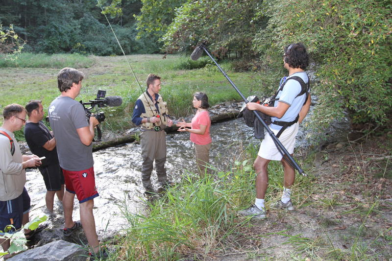 EarthEcho President Philippe Cousteau discusses the health of a trout fishing stream in Grant County W.Va. with Jenny Newland, Canaan Valley Institute executive director, for a documentary about the Chesapeake Bay watershed.