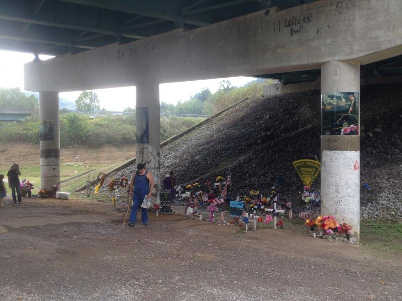The support columns of the overpass on the I-79 interchange have become a memorial for Bailey and Workman. The two officers were killed stemming from an incident that happened along the Roane-Clay County line on August 28, 2012.