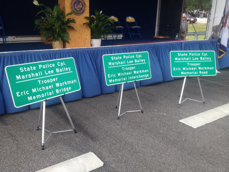 Highway signs honoring fallen State Police officers.