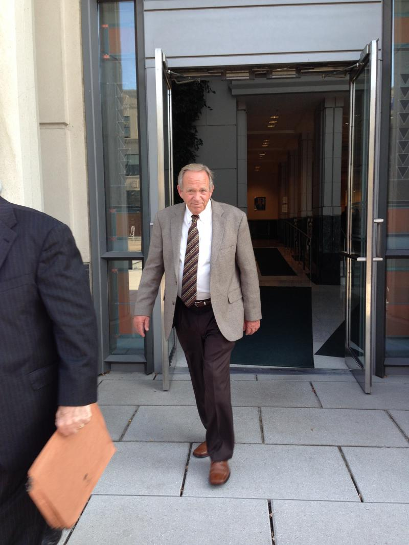Mingo County Commissioner David Baisden walking out of the U.S. District Courthouse in Charleston.