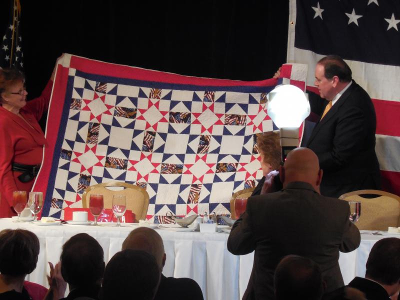 Brenda Garcie, wife of Summers County GOP Chair Joe Garcia, presented Huckabee with a handmade quilt.