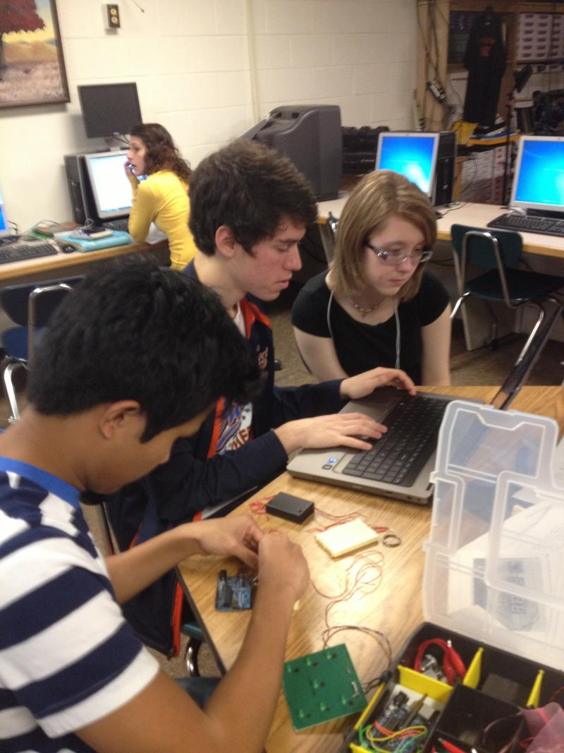 South Charleston High School students working on the CubeSat