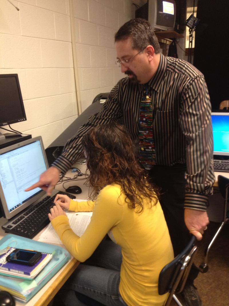 Teacher Joe Oliver assists student Tiffany Grigsby