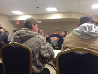 Laid off miners attend a rapid response meeting