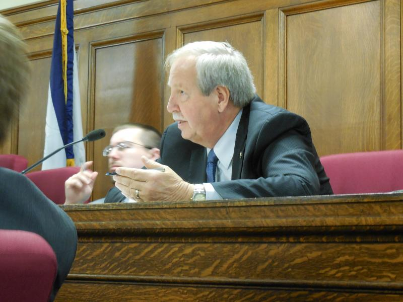 Senator Bob Williams questions the cost of the BTOP expansion project during a Joint Committee on Technology at the Capitol.