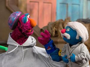 Telly and Coach Pogolyi train for the Pogo Games as Sesame Street.