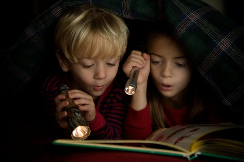 Kids reading in the dark