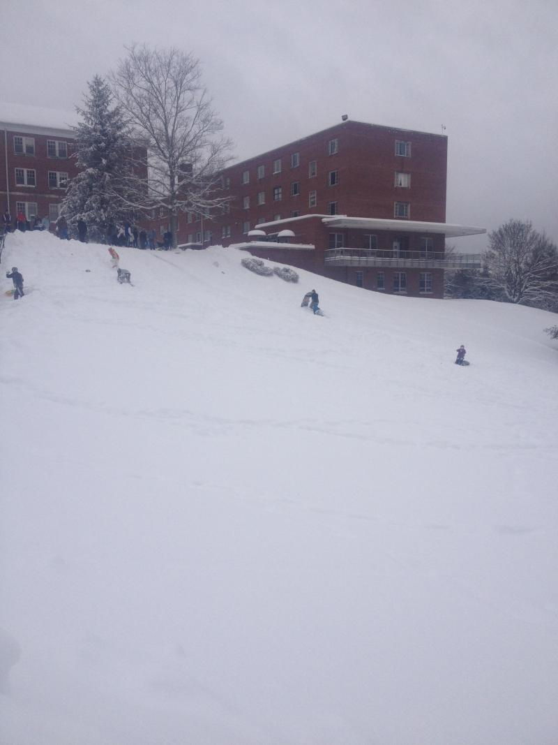 "Students and families enjoying the snow day at Concord University, also called ""Campus Beautiful""."
