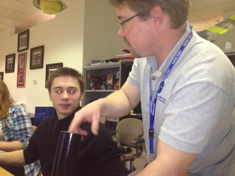 Todd Ensign works with student Jack Thompson.